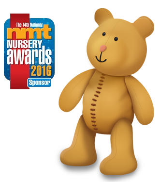 Stanley bear stood next to nmt award badge